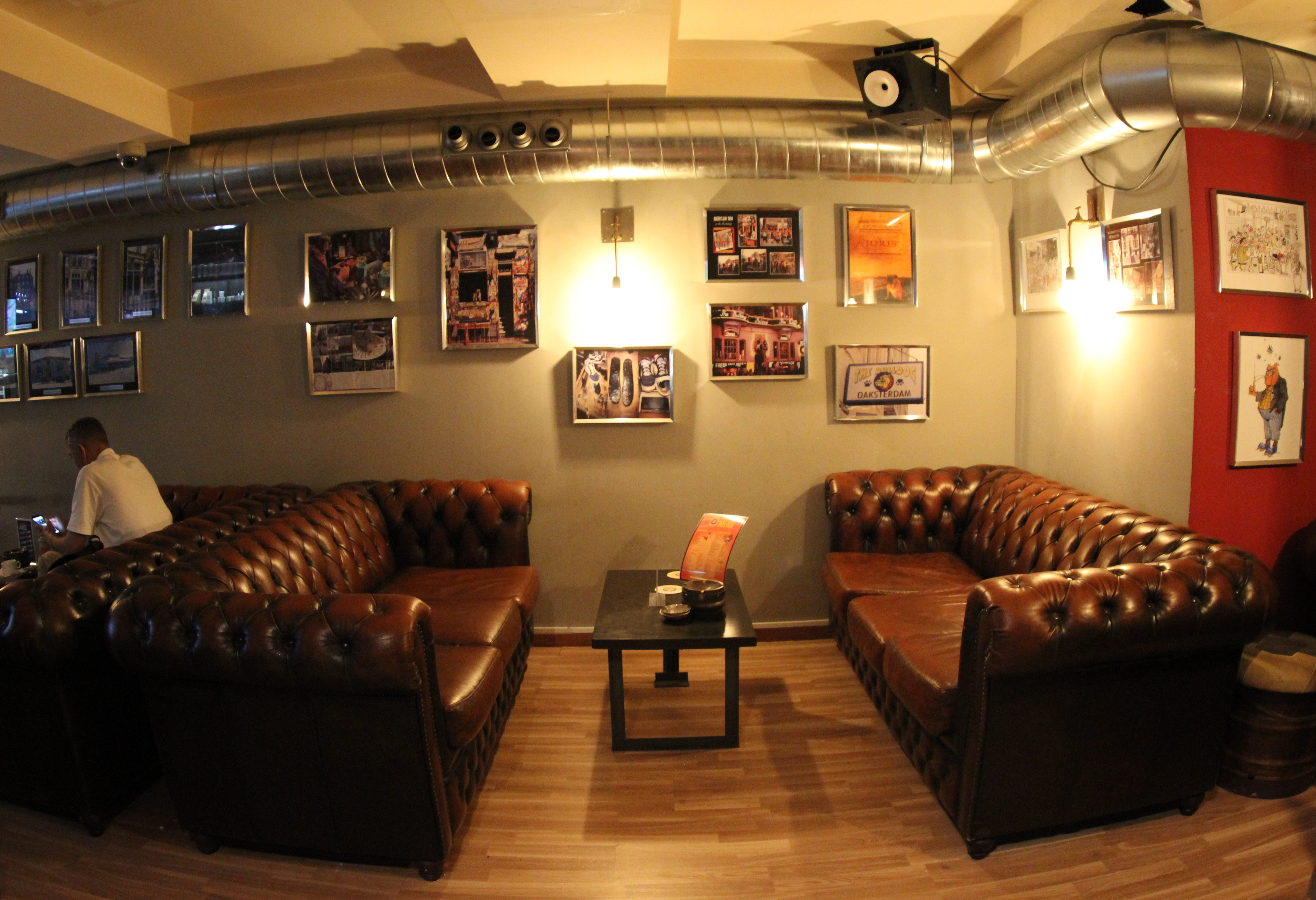 marihuana shop sofas and table with walls decorated with pictures